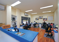 A purpose built sales room catering for up to 6 salesmen and their workstations